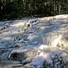 Half frozen waterfalls on Cascade Brook.