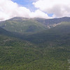 Clouds roll across the summit of Mount Washington as seen from Square Ledge.
