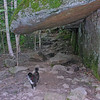 Emma checks ot a natural lean-to on the Square Ledge Trail.