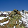 Hiker descends from the summit cone of Mount Eisenhower.