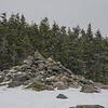 The snow swirled and eddied around the summit...