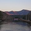 The setting sun casts its glow on The Imp (L) and North Carter above the dam.