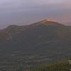 Dawn light illuminates the summit of Mount Monroe.