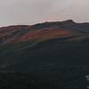 The setting sun lights up Boott Spur.