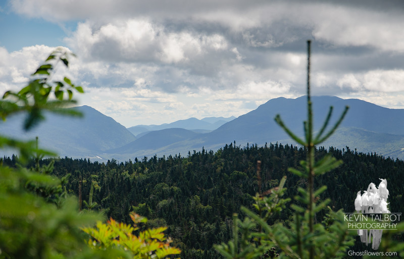 Zoom to Crawford Notch, Mount Webster (L) & Willey Range (R) Moats & Chocorua on horizon...