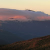 The summit breaks through the cloudcap just as the sun sets.