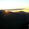 Sun dips behind Mount Field.