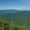 View southwest over the Dartmouth Range to Bretton Woods, then beyond to Franconia Ridge.