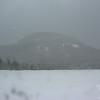 Cannon Mountain through the falling snow.