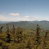 Jennings Peak below us, Tecumseh, Moosilauke and Franconia Ridge beyond.