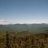 (L to R) Franconia Ridge, The Osceolas, the Hancocks and Mount Carrigain.