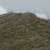 Zoom of hiker descending from South Moat.