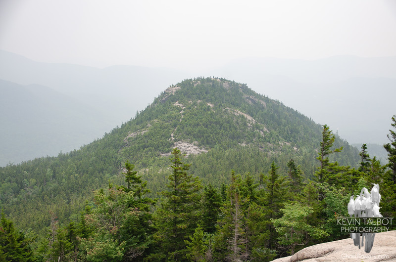Looking back at  Welch as we ascend Dickey, ghostly hills to the south barely visible in the haze...