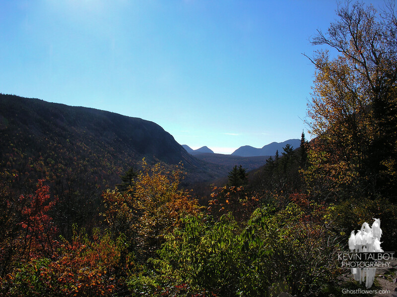 View past Whitewall Mountain to Carrigain Notch from the front porch of the AMC Zealand Falls Hut.