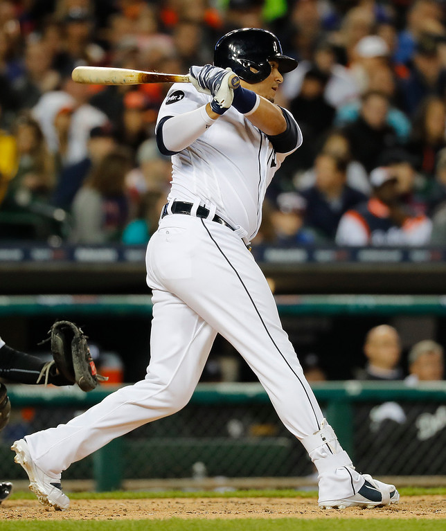 . Detroit Tigers designated hitter Victor Martinez hits a one-run single against the Chicago White Sox in the fifth inning of a baseball game in Detroit, Friday, April 28, 2017. (AP Photo/Paul Sancya)