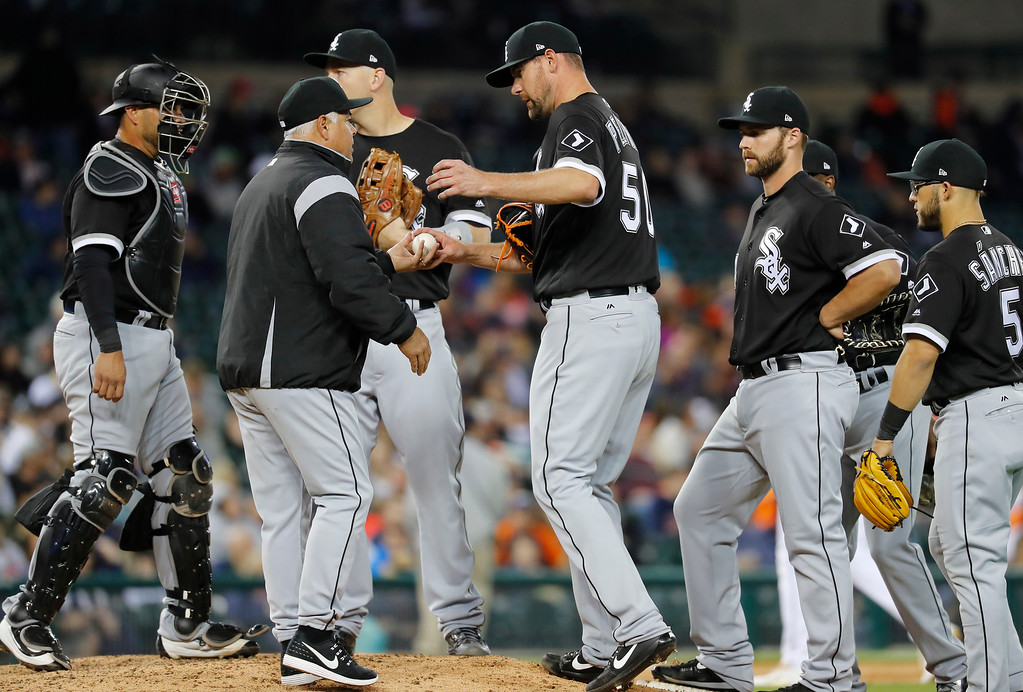 . Chicago White Sox manager Rick Renteria takes the ball from pitcher Mike Pelfrey (50) against the Detroit Tigers in the fifth inning of a baseball game in Detroit, Friday, April 28, 2017. (AP Photo/Paul Sancya)