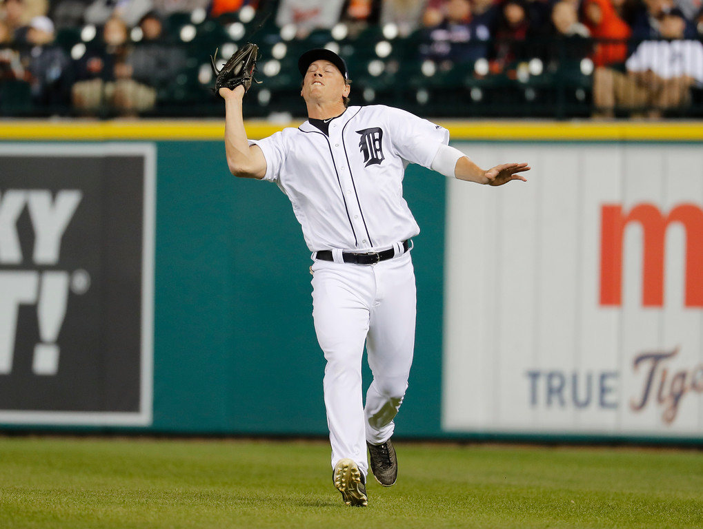 . Detroit Tigers right fielder Jim Adduci catches a Chicago White Sox right fielder Avisail Garcia fly ball in the fifth inning of a baseball game in Detroit, Friday, April 28, 2017. (AP Photo/Paul Sancya)