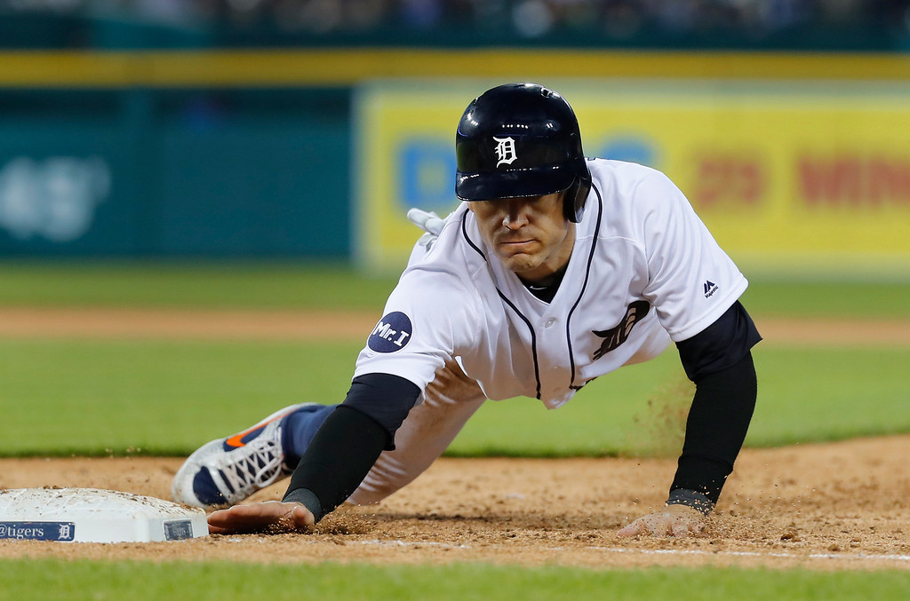 . Detroit Tigers\' Ian Kinsler dives safely back into first base against the Chicago White Sox in the fifth inning of a baseball game in Detroit, Friday, April 28, 2017. (AP Photo/Paul Sancya)