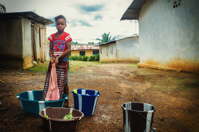 Monrovia, Liberia October 8, 2017 -  A young girl washes clothes.