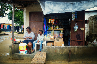 Monrovia, Liberia October 6, 2017 - Jacqueline Clinton,  a student in the REVSLA program who owns her own general store, sits with her daughter Moseline.