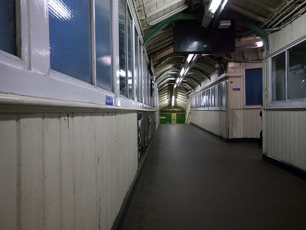 2011, January, inside the old wooden footbridge linking the north and south Underground line platforms. The corridor to the right of the photograph linked down to what was by the time of this photograph the Overground lines..