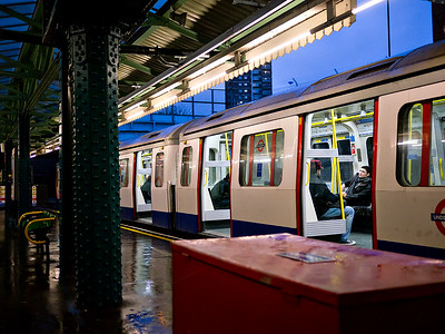 2011, January, a Hammersmith and City Line Underground train at rest on the outer  platform.