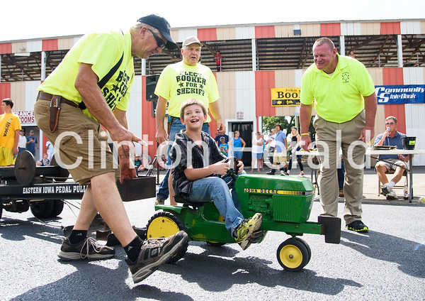 Logan Rush, 7, of Morrison, Ill. competes in the peddle pull competition at the Whiteside County Fair on Tuesday.