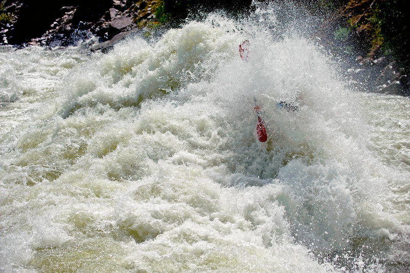 Evan Garcia in Juicer Rapid at 8000cfs.<br /> North Fork of the Payette Rier, Idaho Whitewater.<br /> Photo by Mike Reid.