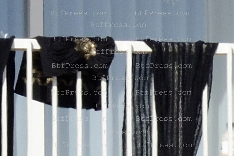 EXCLUSIVE______Whitney Houston death at the Beverly Hilton in Los Angeles. General views show Whitney Houston's blanket, scarf and black dress hanging on the balcony rail of the room she was found dead in at the Beverly Hilton Hotel in Beverly Hills, CA on February 12, 2012.