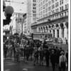 Looking northwest along Spring Street from the corner of Seventh Street as pedestrians crowd the crosswalks and sidewalks