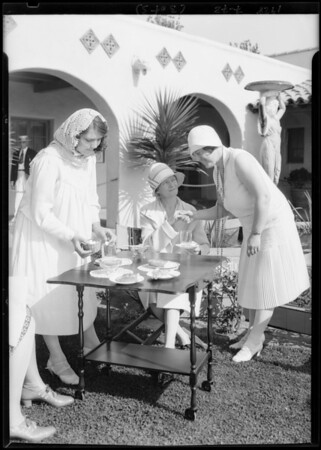 Serving tea at office on tract at Hollywood Riviera, Redondo Beach, CA, 1928