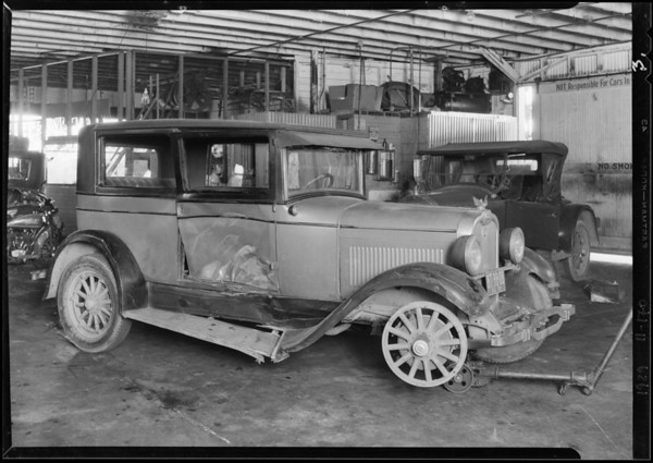 Wrecked Oakland and motorcycle at Slaten Garage - for Sawtelle police station, Southern California, 1929