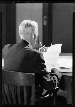 Business man reading policy, Southern California, 1930