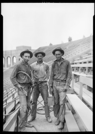 USC trackmen at work in coliseum, 3911 South Figueroa Street, Los Angeles, CA, 1925