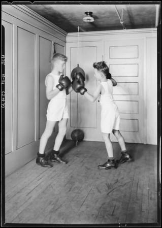 Boy at punching bag, Christmas topics, Broadway Department Store, Los Angeles, CA, 1925