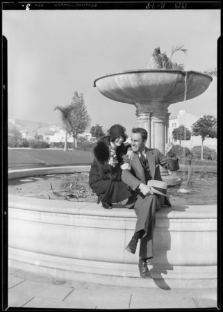 Breakfast club, Priscilla and Sean at fountain, Southern California, 1929