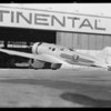 Transcontinental and Western Airlines mail plane at Glendale airport, Glendale, CA, 1931