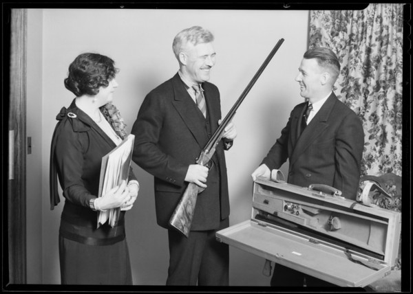 Presenting gun to Mr. Barneson, Southern California, 1930