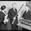 Presenting gun to Mr. Barneson, Southern California, 1930