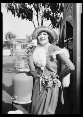 Publicity shots with Ina Claire on roof, Southern California, 1929