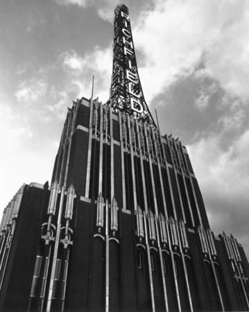 A low-angle view of the Richfield Tower atop the Richfield Oil Corporation Building