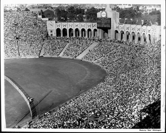 A high-angle view of a capacity crowd at the Los Angeles Memorial Coliseum