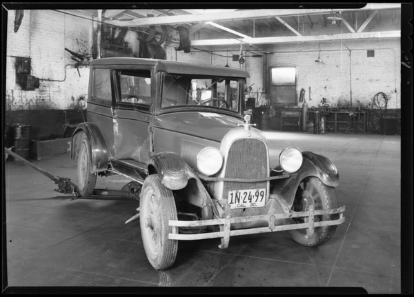 La Sage wrecked Whippet in garage, 3110 South Main Street, Los Angeles, CA, 1930