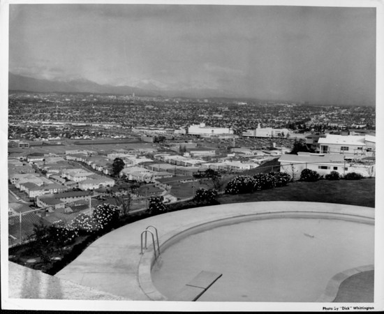 Small residential community of principally apartments overlooking downtown Los Angeles and the mountains in the distance