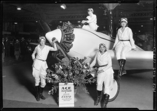 Girls on ship at booth in Aero Exposition at Mines Field [Los Angeles International Airport], Los Angeles, CA, 1928