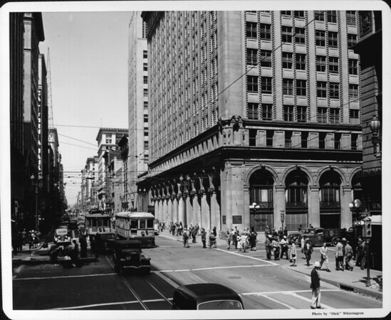 Looking north along Broadway at Seventh Street as pedestrians and trolley cars fill the travel about