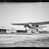 New exterior hangar, plane taking off, cockpit of plane, Southern California, 1929