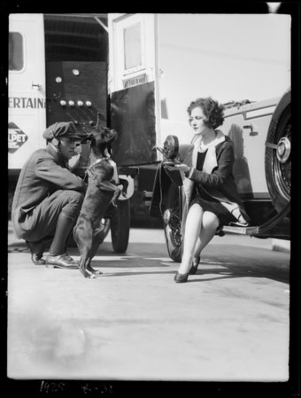 Calpet, dog, woman on car at filling station, Southern California, 1928