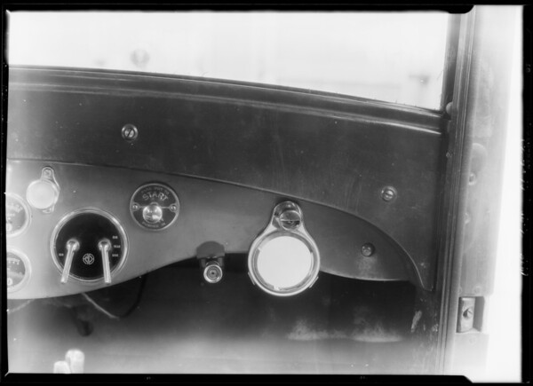 Mrs. Brye with auto hand mirror and light, Southern California, 1928