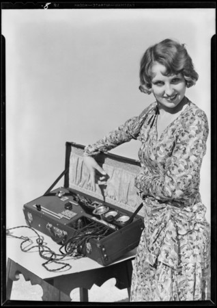 New carburetor and testing panel with Connie La Mont, Electrical Equipment Co., Southern California, 1930